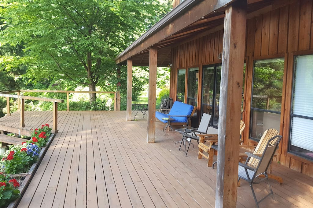 Covered and open deck with tables, chairs, BBQ