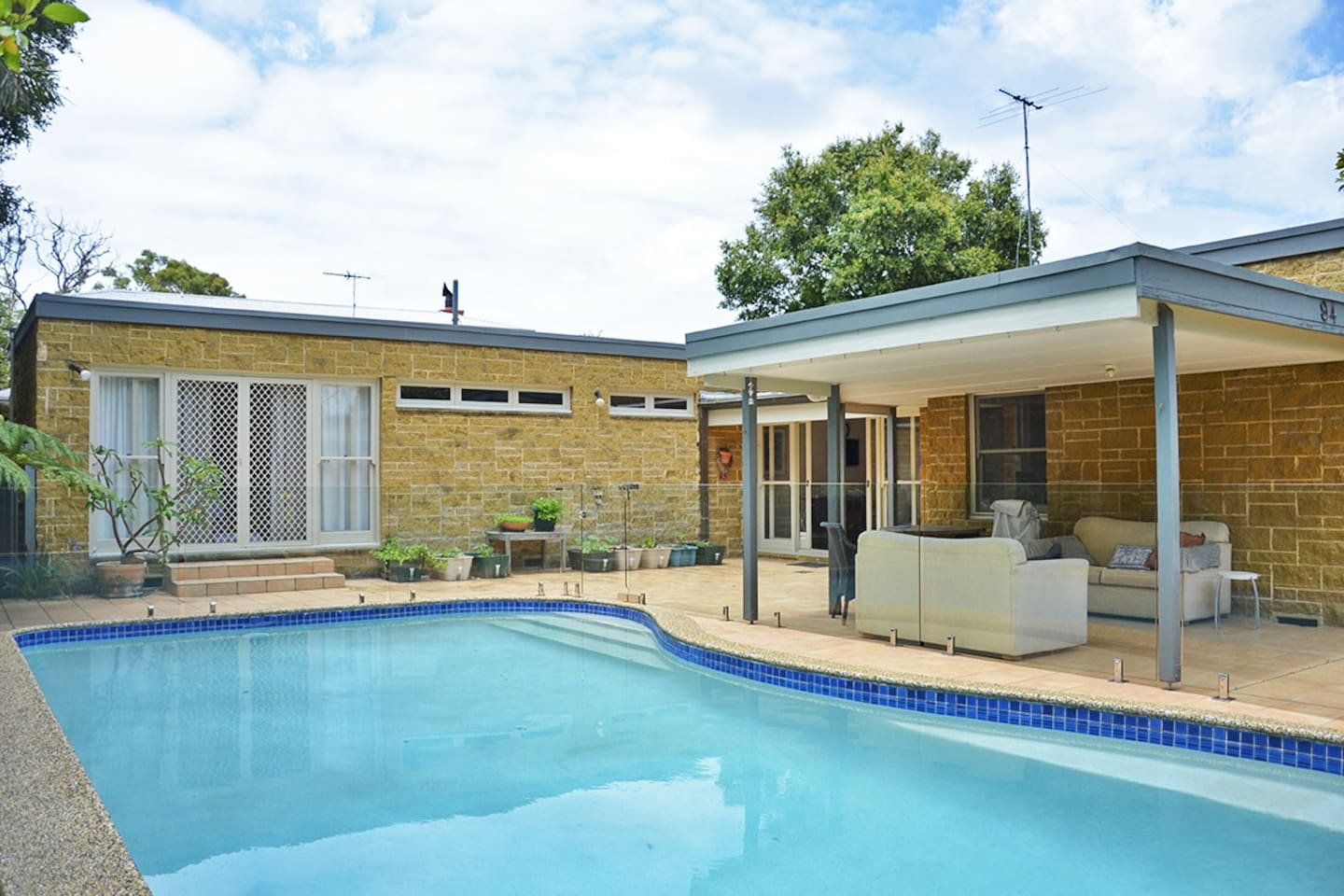 Outside of the house with 9m fenced heated swimming pool.
