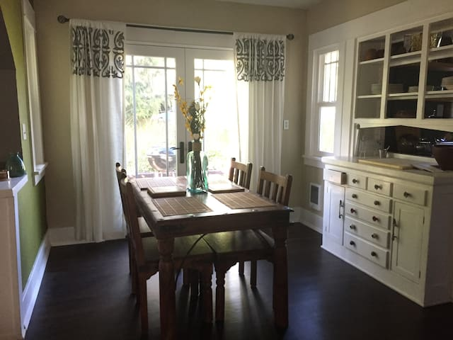 Dining room with French doors opening to backyard