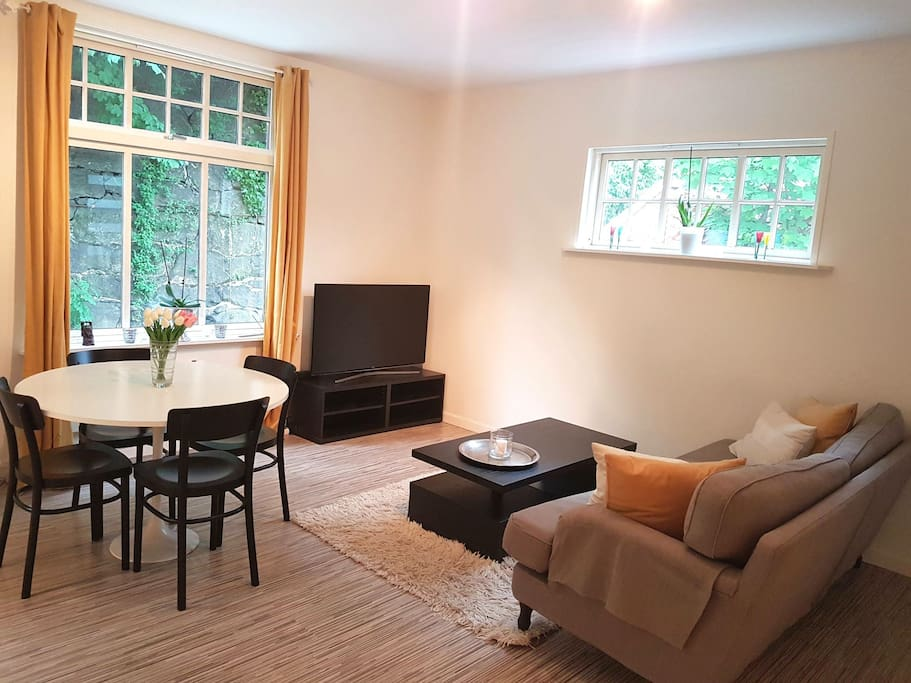 Cosy livingroom. Large windows give lots of light into the room.