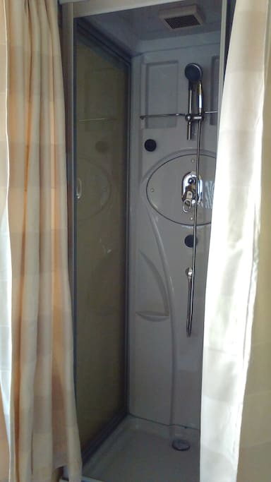 Shower booth in the same room as dinning table installed