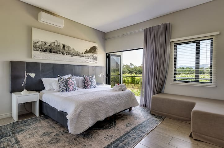 Open plan room with King Bed and seating space