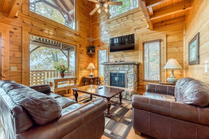 Log cabin w/breathtaking mountain views, private hot tub, & shared pool, sauna