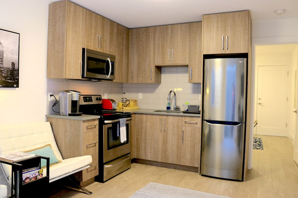 Fully equipped kitchen with stainless steel appliances and Keurig espresso machine