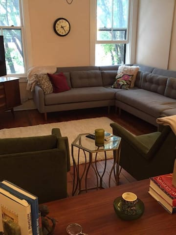 Living room on second floor with sectional couch.