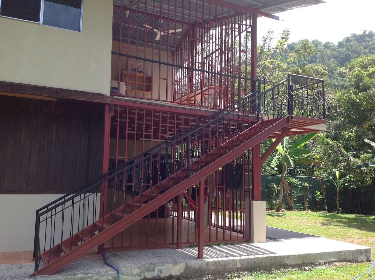 Stairway to upstairs Kitchen, Verandas and Rooms...
