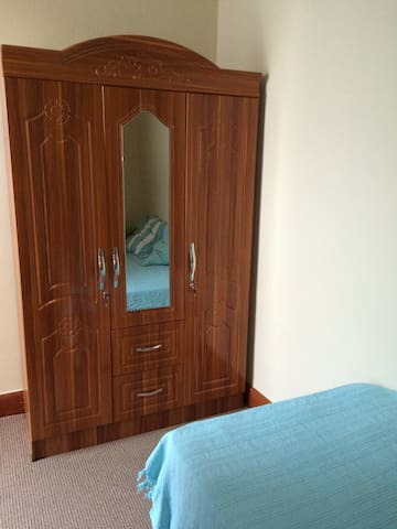Spacious, lockable cupboard with ample shelving, drawers & hanging space.