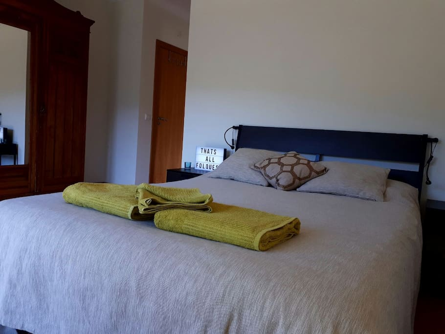 Comfortable double bedroom with en suite bathroom and balcony overlooking the mountains.