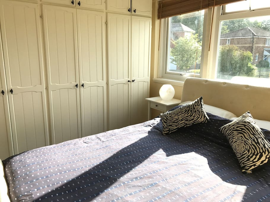 Master bedroom with one Queen sized double bed and wardrobes