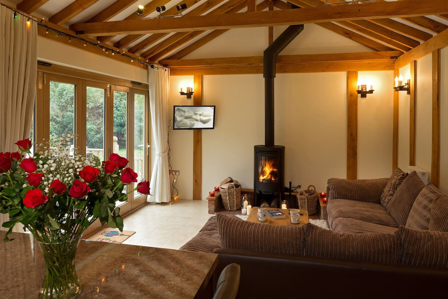 Owl's Hoot lounge with vaulted ceiling and exposed beams.