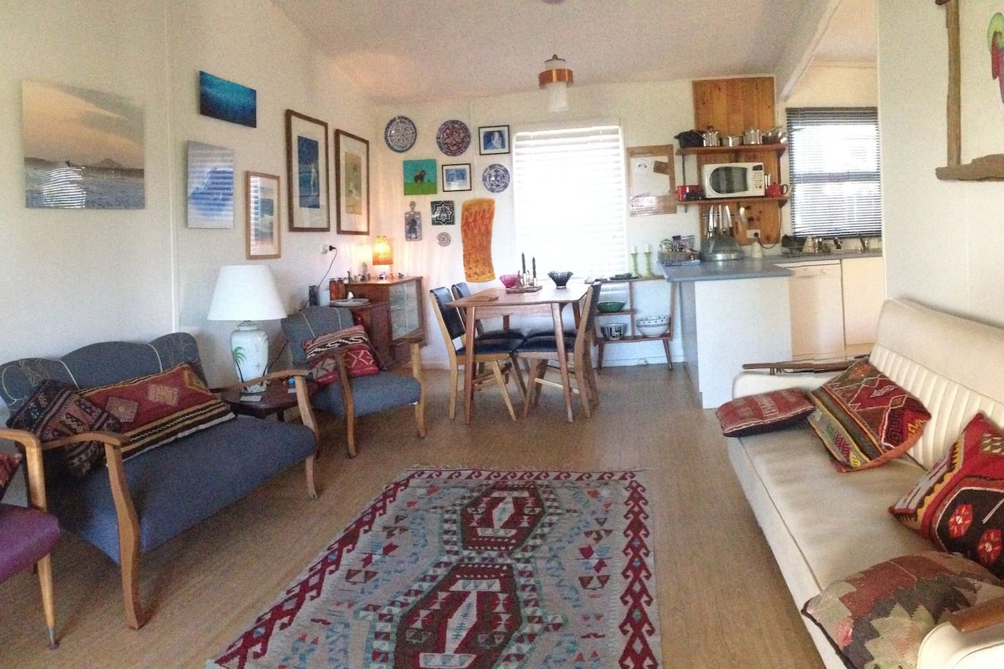 Original art and mid century furniture make a fabulous living area, with comfort & style