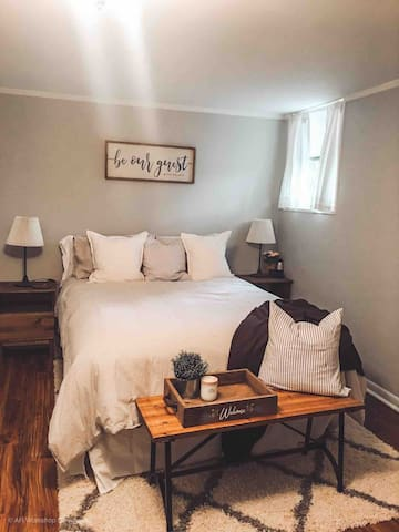 Enjoy the cozy bedroom fit with a queen size bed and dresser. Here you can relax and sleep in! We offer a mixture of soft and firm pillows and a light down comforter. We even have a table-top fan & alarm (if you need it)!
