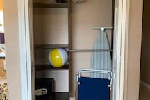 Spacious closet with shelves, iron, ironing board, security safe, and 2 beach chairs