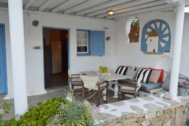 Traditional Mykonian cottage next to sandy beach