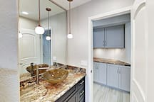 Bathroom with stylish sink and downlights