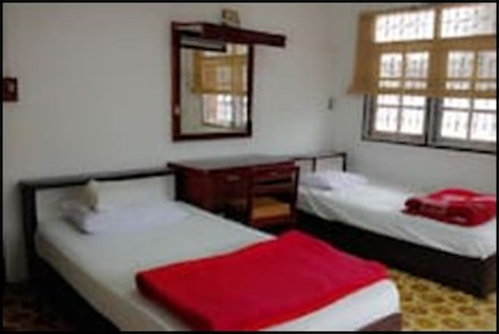 room with twin bed with fans.(a ventilator +2 table fans.)