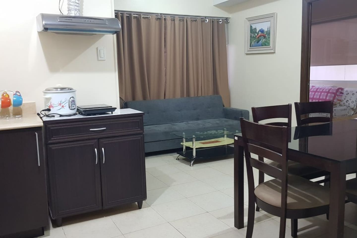 Living area with sofabed (grey sofa) good for 2 pax