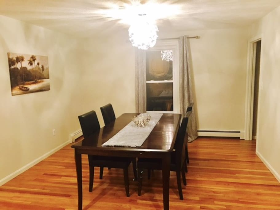 Dining table with four leather chairs.
