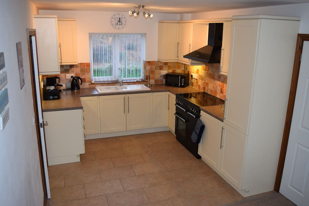 Well equipped kitchen with separate utility room