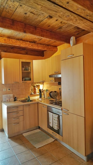 A full kitchen is ready to be used and is fully equipped.