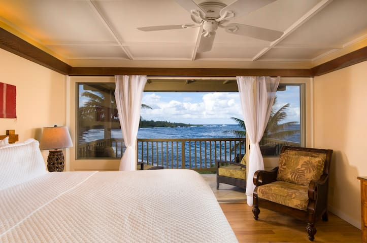 Master bedroom with views out to beautiful Hana Bay.