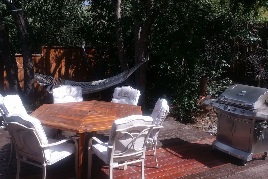 Our backyard, deck with BBQ and hammock