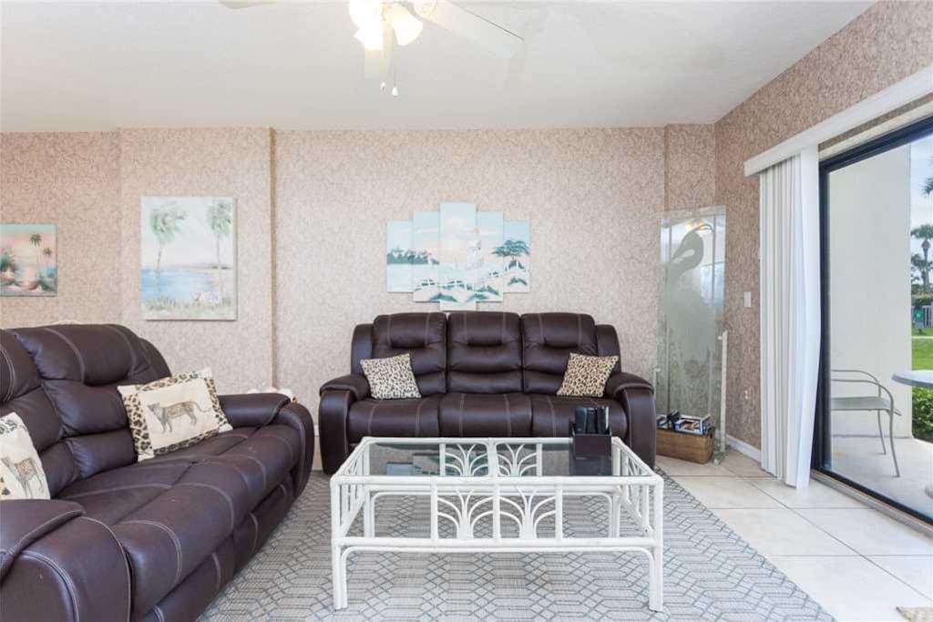 Spacious Living Room - Large comfortable couches and ceiling fan so you can enjoy your evenings with family and lots of breathing