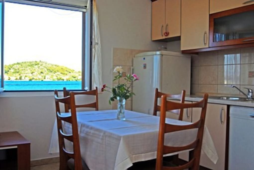 Kitchen with a view to Osljak- smallest inhabitet island of the Adriatic sea