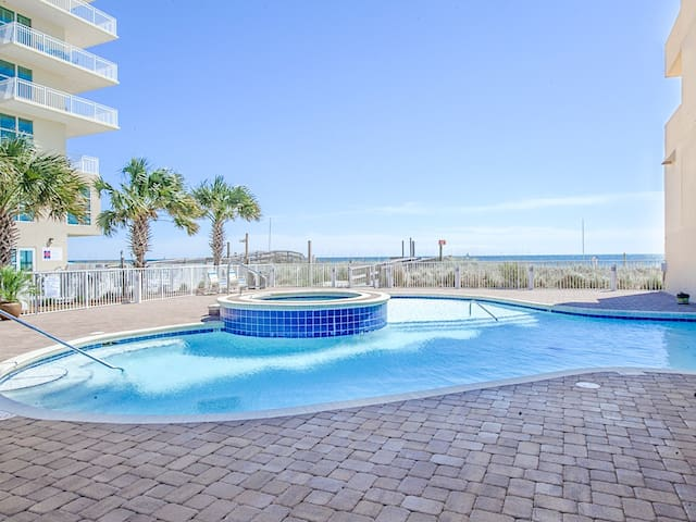 Relax in the outdoor pool and hot tub after a fun-filled day at the beach.