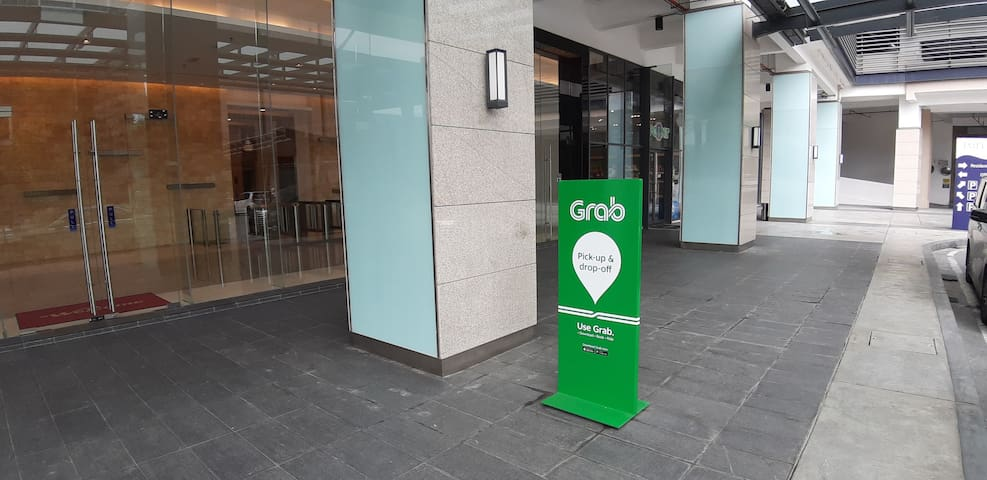 Walk to the Office Tower opposite the apartment building to wait for your Grabcar.