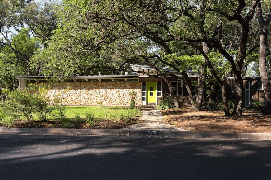 Exterior Entry under grove of live oaks