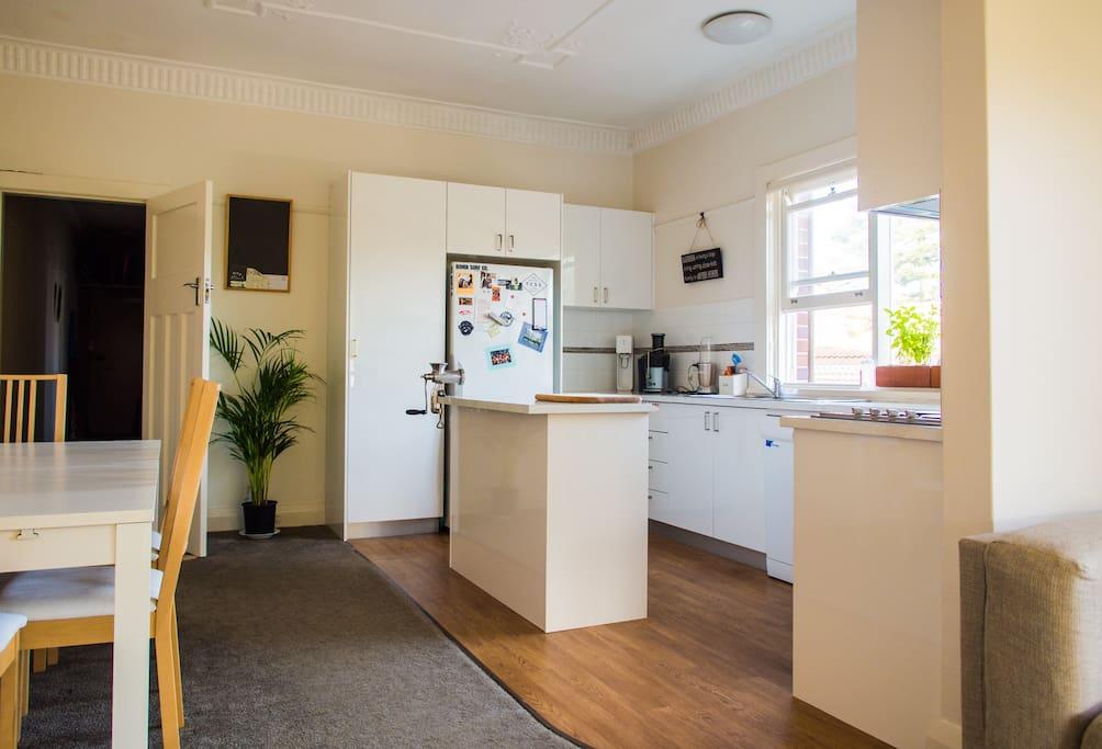 Sociable kitchen overlooking dining area.