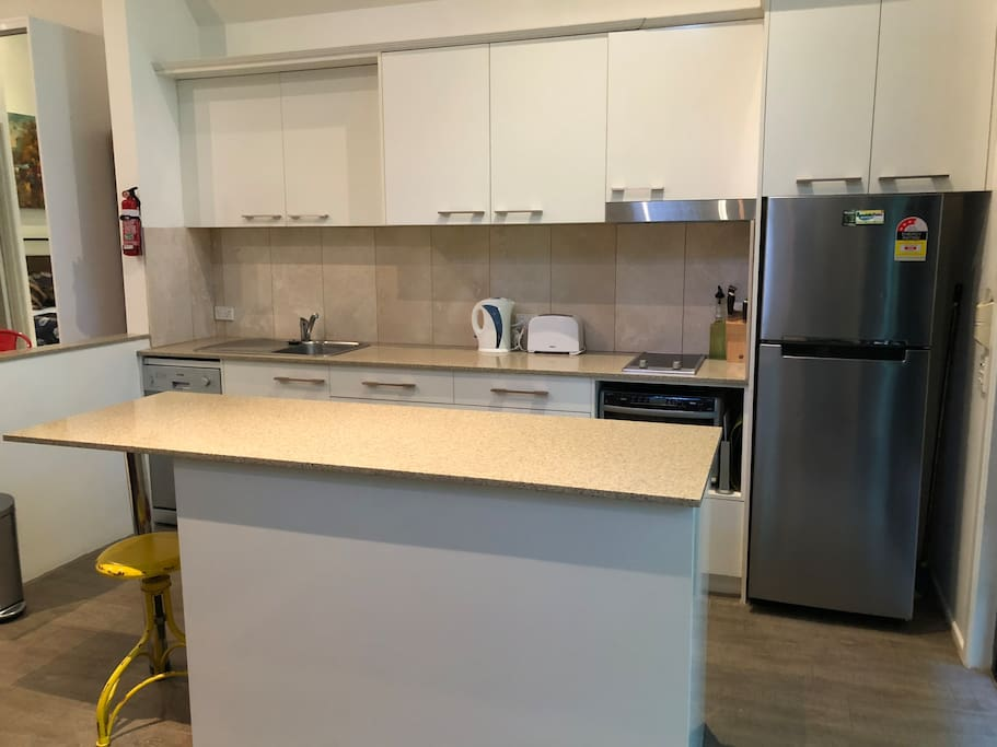 Fully equipped kitchen includes dishwasher and washing machine/dryer