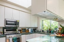Fully equipped kitchen with full stove, microwave with convection oven option, instant hot water, ice maker and ice water from fridge