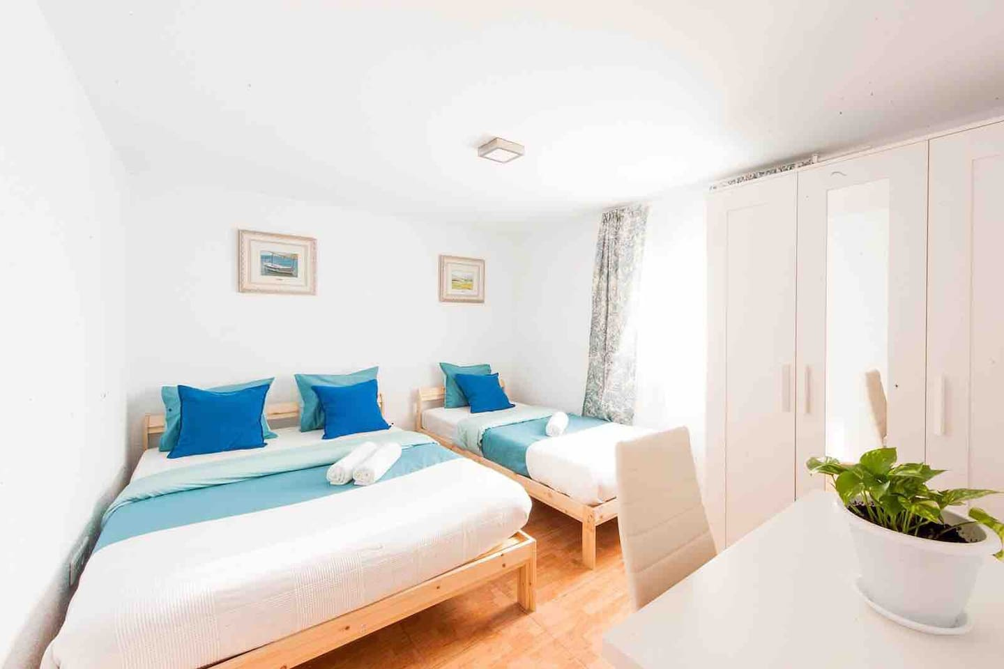 Your private room with double bed and one individual bed. The bedroom's door has a lock.