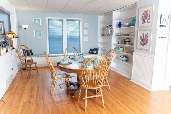 Dining area.  Table extends to fit large group.  Perfect for family gatherings or playing games.    The shelves contain a small video library, games, extra glasses, and coloring book/crayons for the kids!  There is also a desk not pictured.
