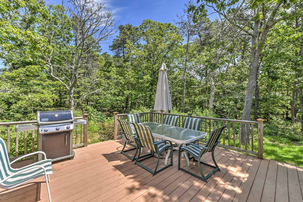 An outdoor deck with ample seating and a grill is the perfect spot for lounging in the sun.