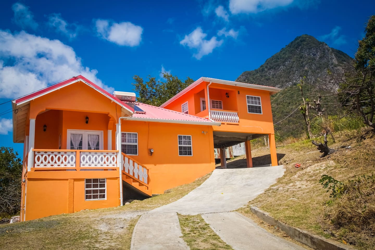 Beautiful inside and out. Vinaya's apartments from the outside. Studio apartment above and 2 bed apartment below. With the majestic Gros Piton in the background.