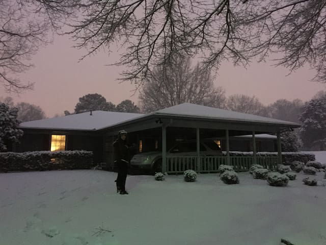 A rare snowy moment of our homey home.