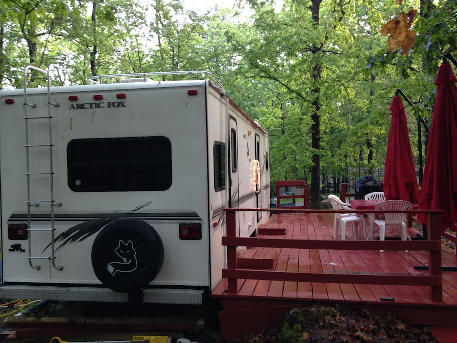 View of the Travel Trailer with deck from the back
