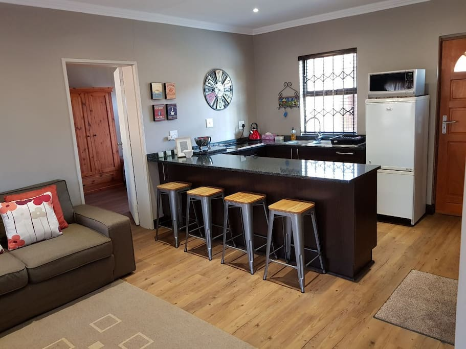 Fully equipped kitchen with electric oven.