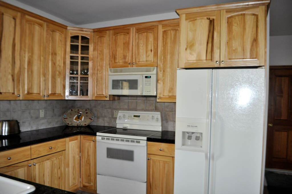 Located on the main level is our fully equipped kitchen includes stove/oven, microwave, refrigerator, dishwasher, pots & pans, coffeemakers, dishes & utensils.