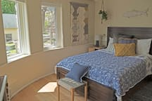 Bedroom 2 on first floor with lake view, queen bed