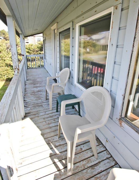 Upper level deck with patio chairs.