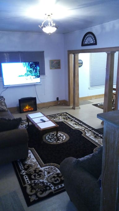 """58"""" Television with electric fireplace"""