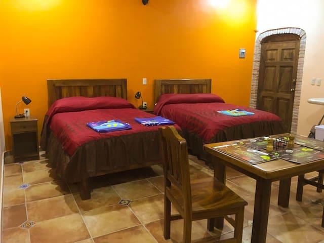 Each bungalow has two comfortable double beds Dos cómodas camas matrimoniales en cada bungalow