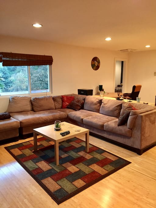 Large family room with microfiber suede large sectional couch