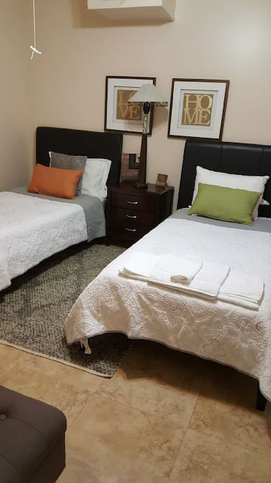 2 twin size beds that can be converted into 1 queen size bed.