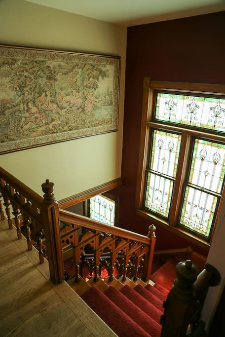 Central Staircase, beautiful stained glass and hanging tapestry.