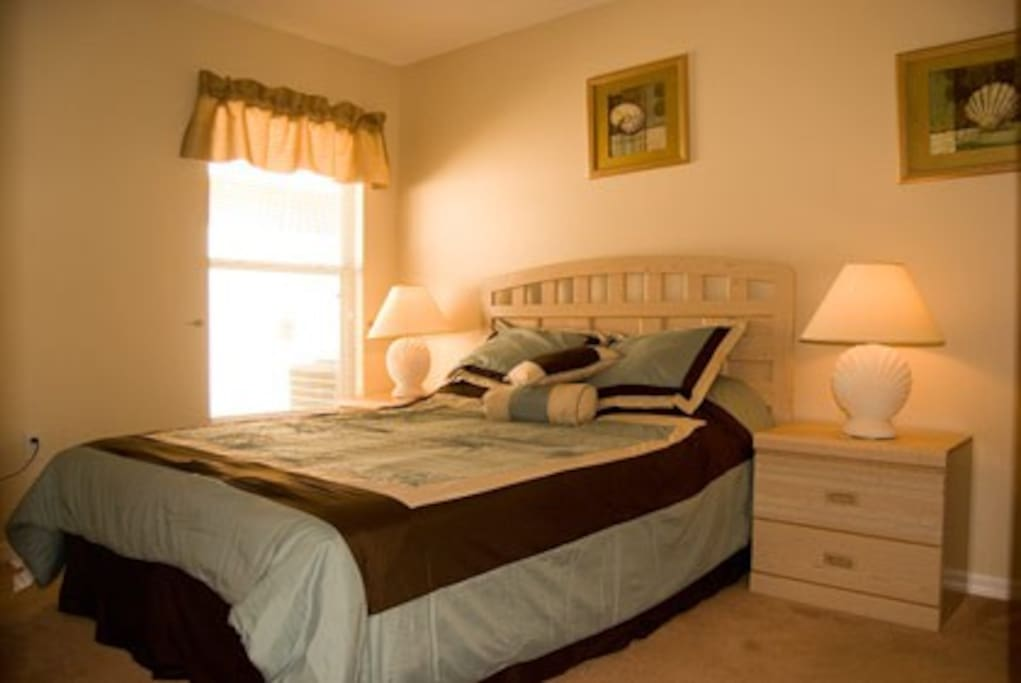 Master bedroom with King sized bed and ensuite bathroom